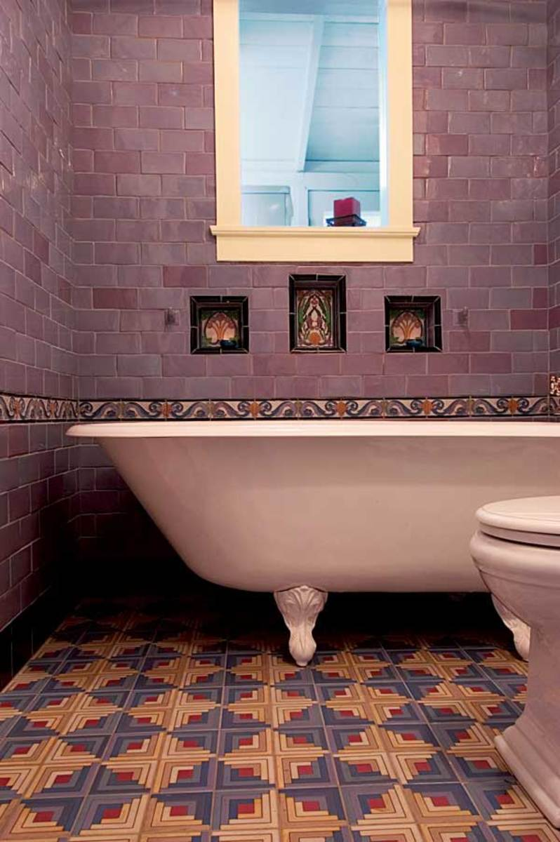 With lavender wall tiles, deco inserts, and a bold geometric tile floor, this recent bathroom by M.E. Tile has a '20s vibe.