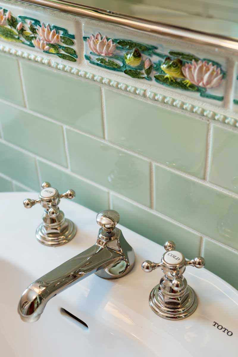 Watery motifs in the embossed tile set the mood in a playful yet spare new bathroom for a 1930 bungalow. Photos by Greg Premru