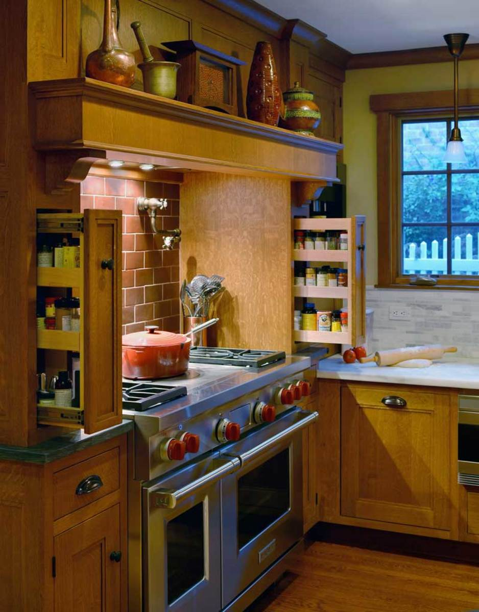Vertical panels around the stove are pullout spice racks.