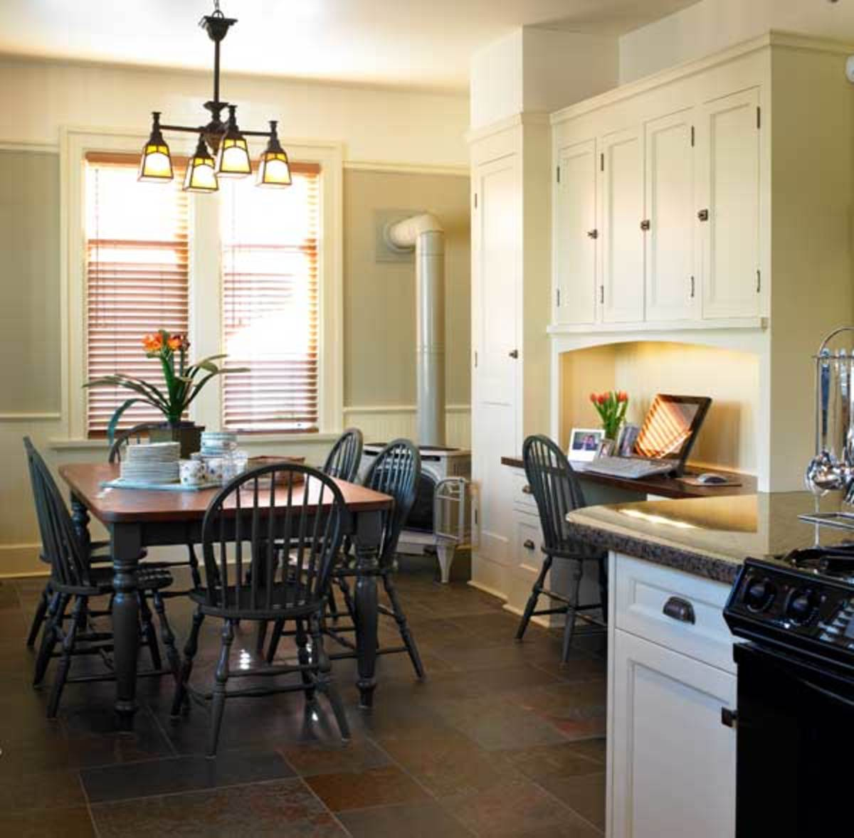 The previously remodeled kitchen was refitted with period wainscot, cabinets, and hardware.