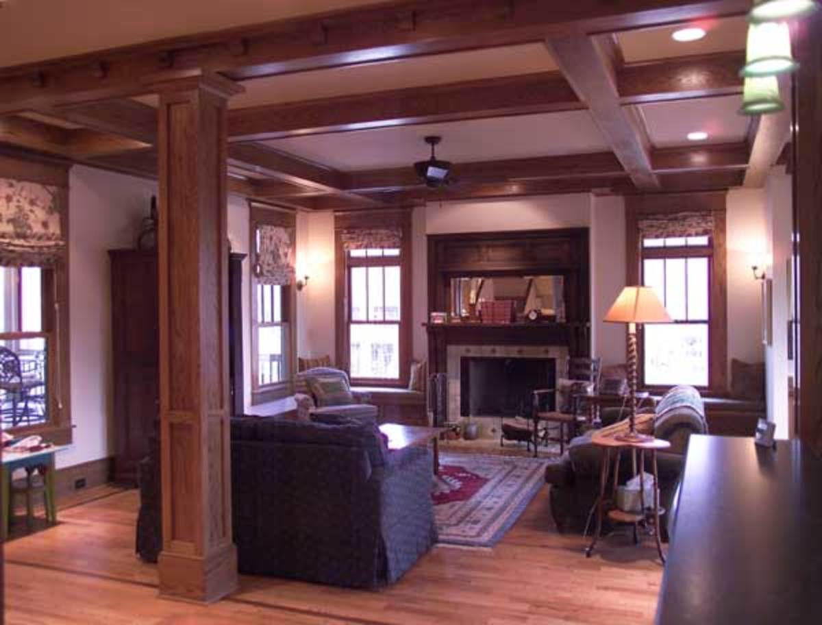 Interior elements are quintessential Craftsman bungalow style, including box beams and colonnades with tapered square columns.