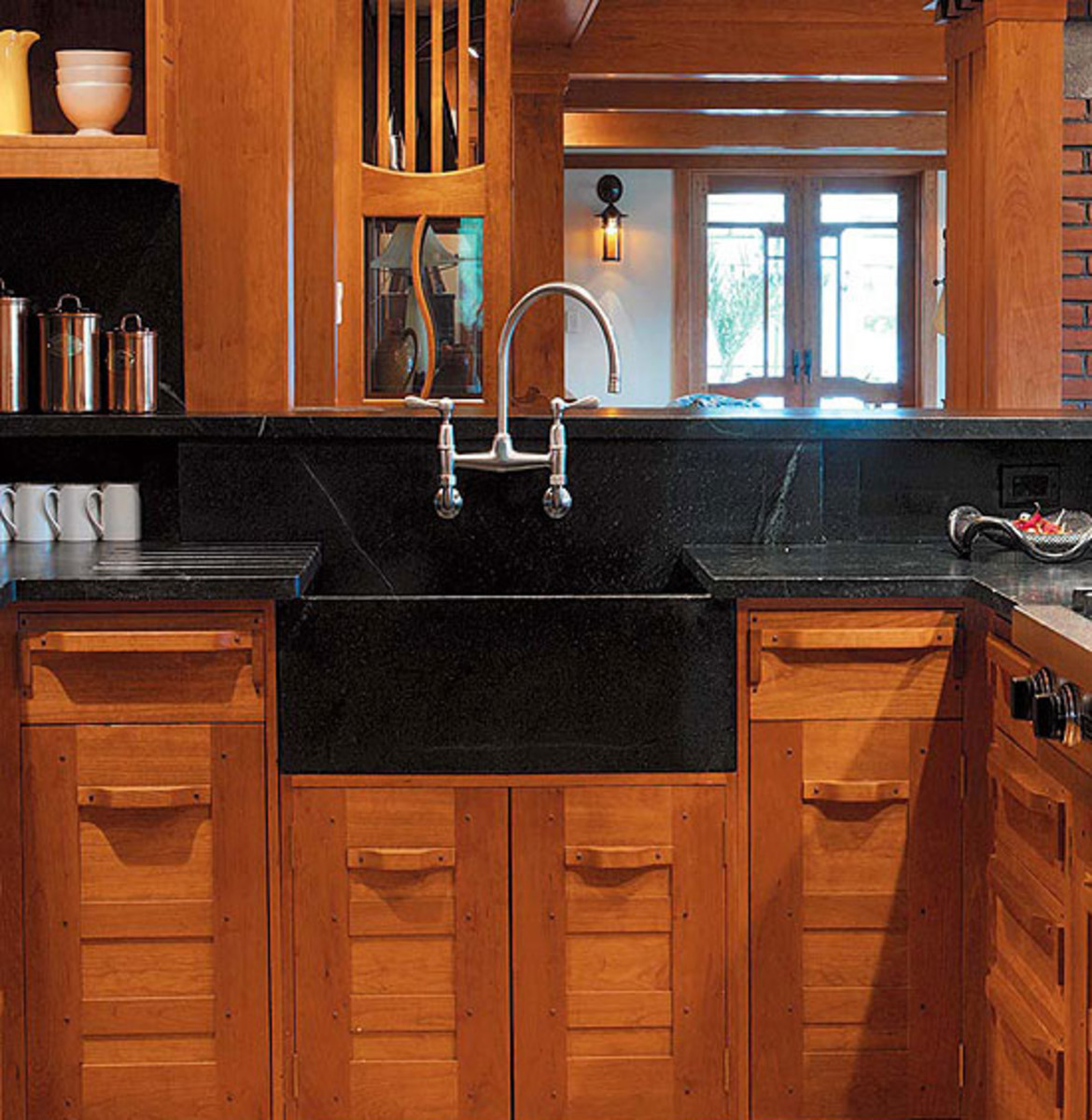 Slate, Soapstone, And Honed Granite Are Timeless Materials For Countertop  And Backsplash, For