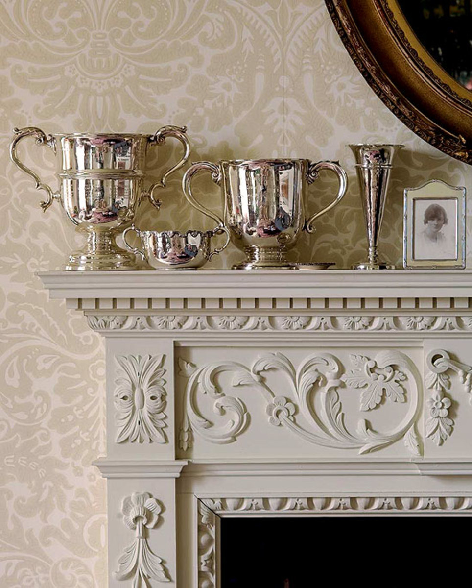 The 'Silvergate' damask paper from Farrow & Ball repeats swirls of classical decoration in the mantel; neutral colors keep it serene. Photo by Edward Addeo.