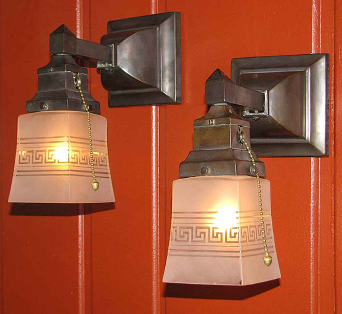 Find antique lighting with original glass; sconces from Materials Unlimited have vintage etched shades.