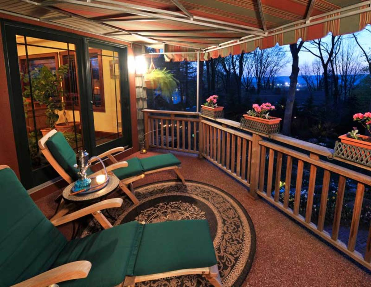 A custom-made retractable awning turns a second-floor porch into another room. Photo: Greg Swisher