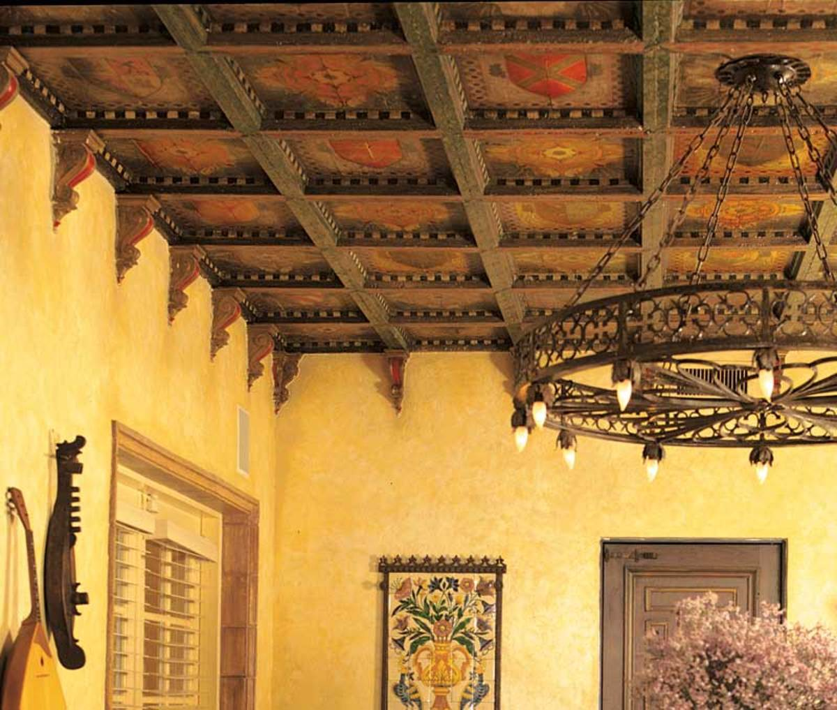 Decorated beams and panels crown a Southwestern Mission Revival dining room. Photo: Lanny Provo