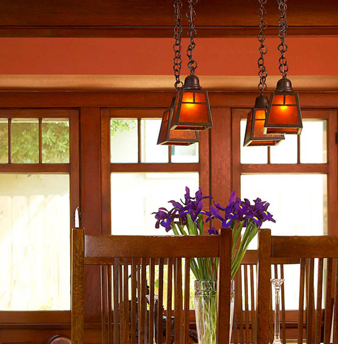 Defining a palette: Mellow drop pendants by Arroyo Craftsman bring out highlights in woodwork and suggested the color scheme in this Pasadena dining room.