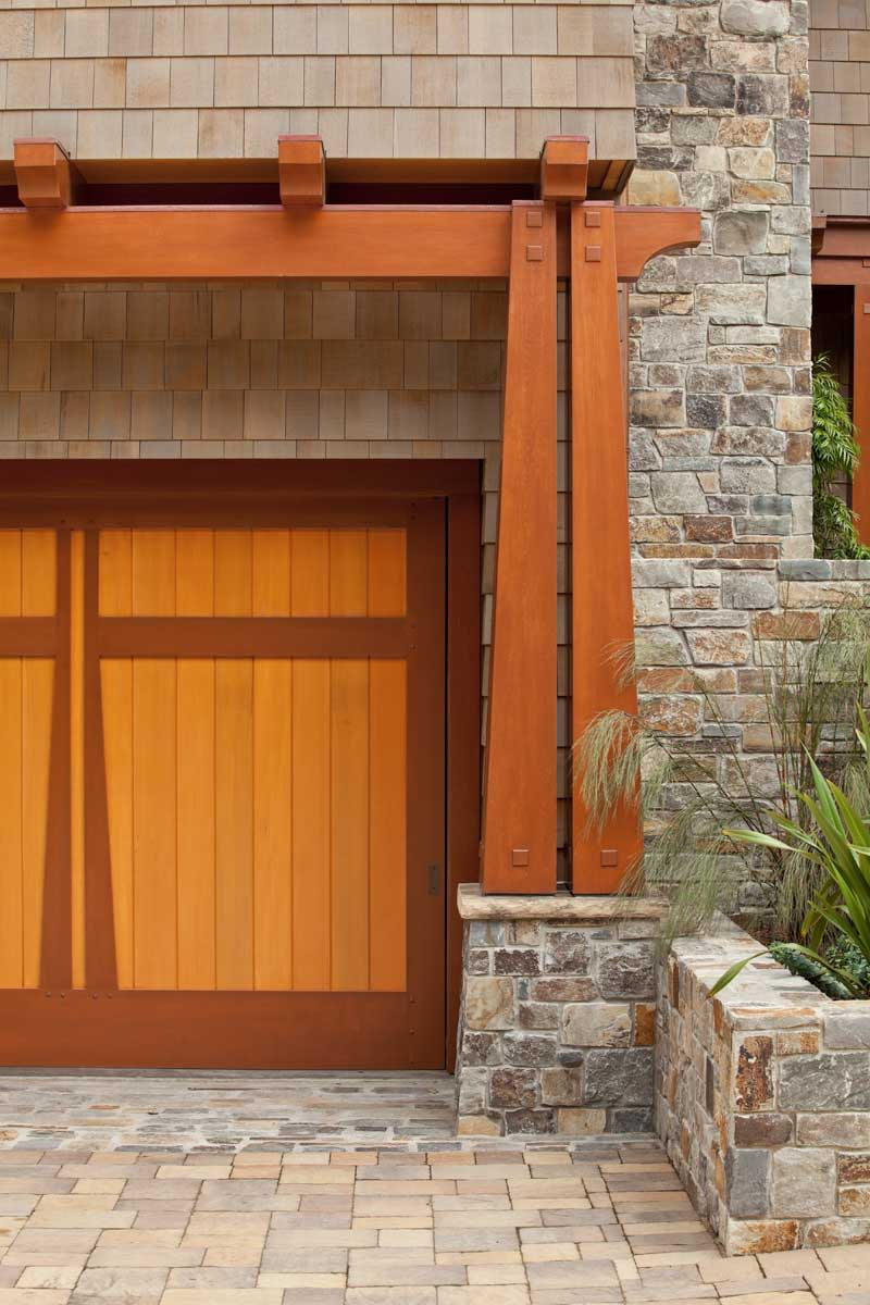 garage doors framed by pergola