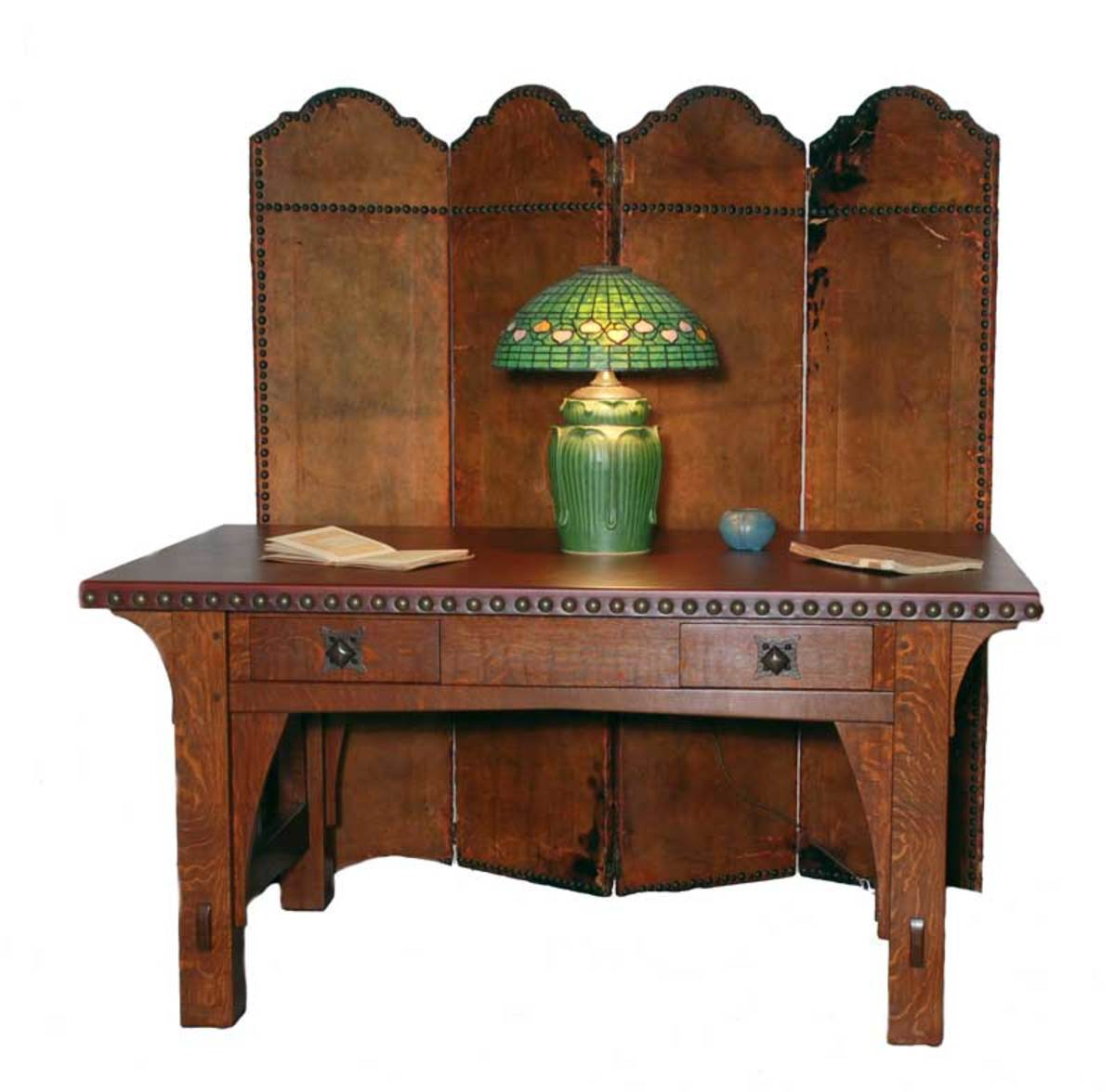 The couple owns the only known example of a 1901 four-panel leather screen, shown with their re-creation of an exceptionally rare Gustav Stickley leather-top table, also from 1901.