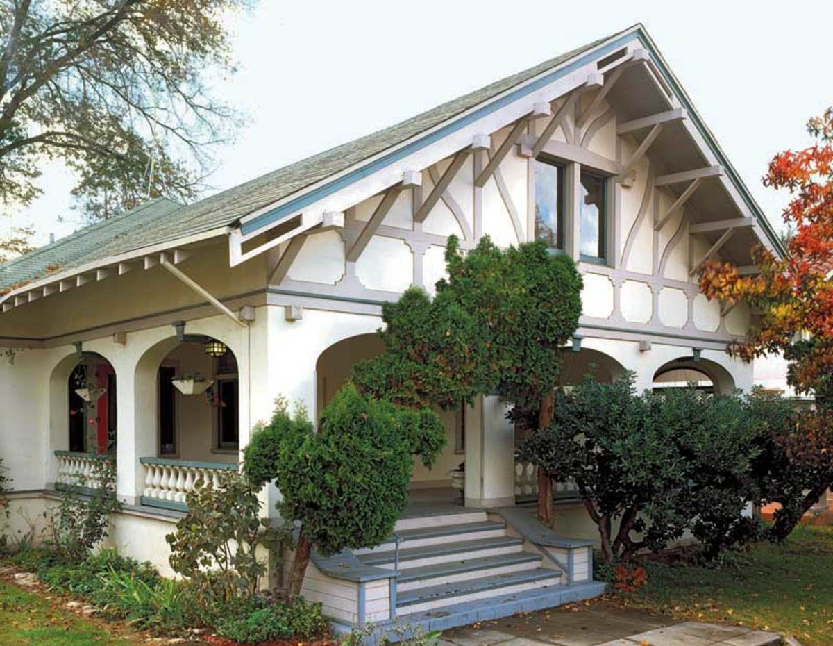 "Fancy ""half timbering"" on the chalet–bungalow is accompanied by an elaborate use of knee braces and a notched bargeboard. Photo: Doug Keister"