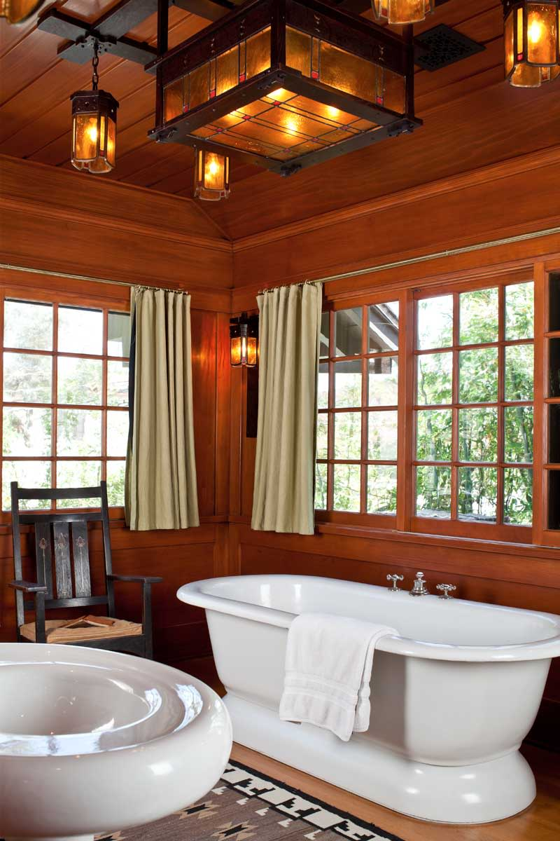 In a revival bathroom, white fixtures with Art Deco styling mix with artful lighting. Photo: William Wright
