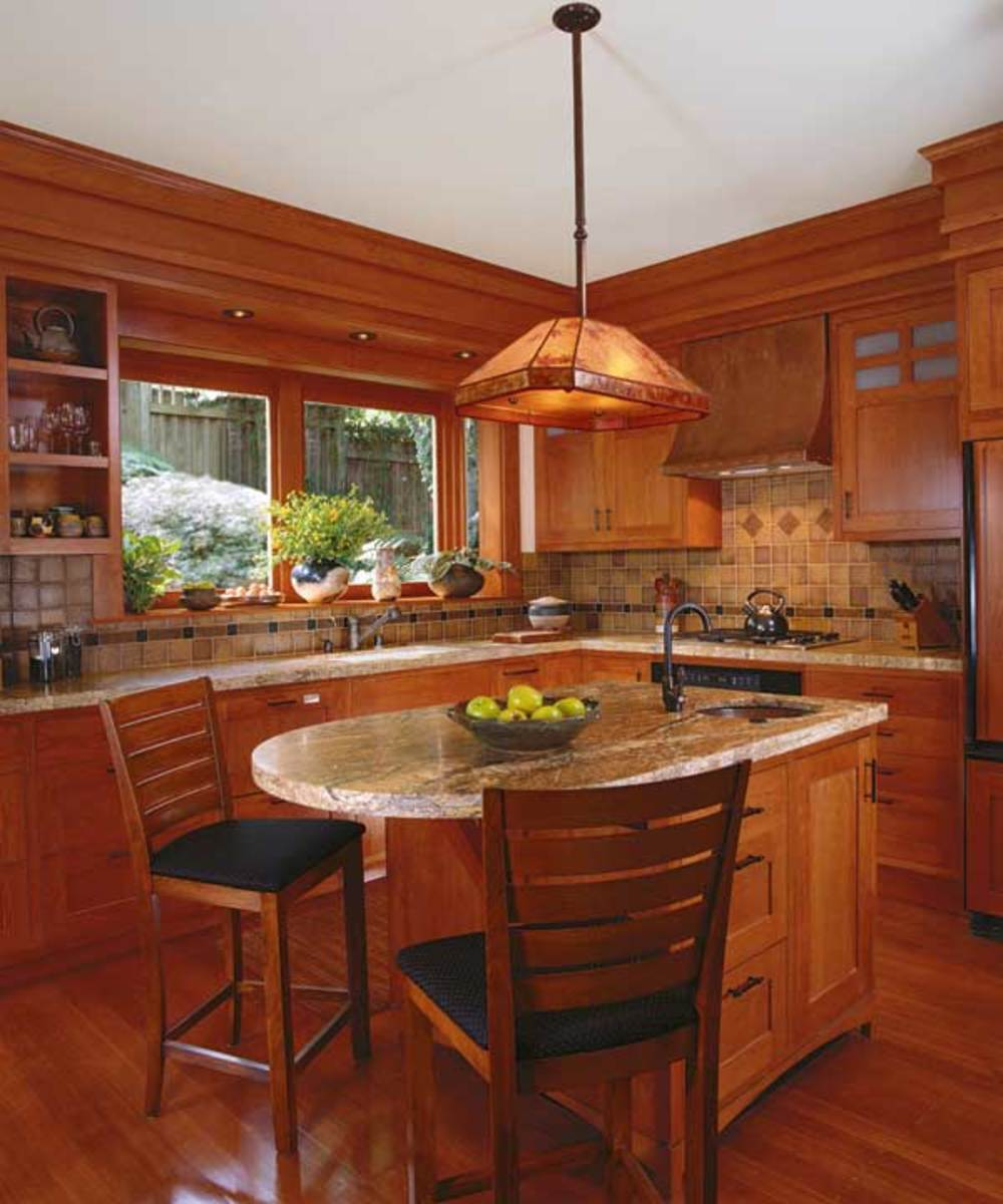 Quality of materials and pleasing colors stand out in this kitchen in Mill Valley, Calif. The cooktop is centered on the far wall, where a refrigerator (not in view) is tucked into the corner to the right of the stove.