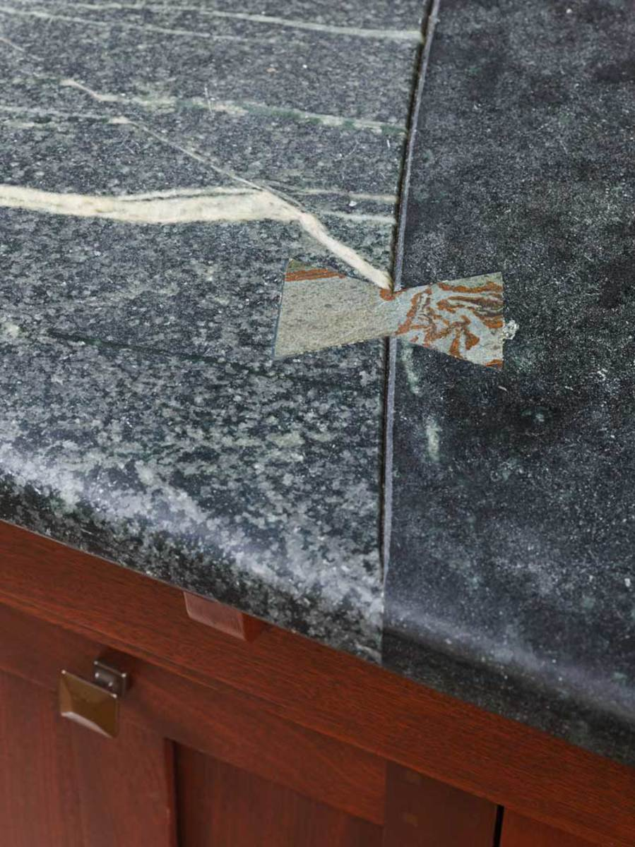 The deep groove emphasizes two contrasting soapstone types connected with an in-laid butterfly joint.