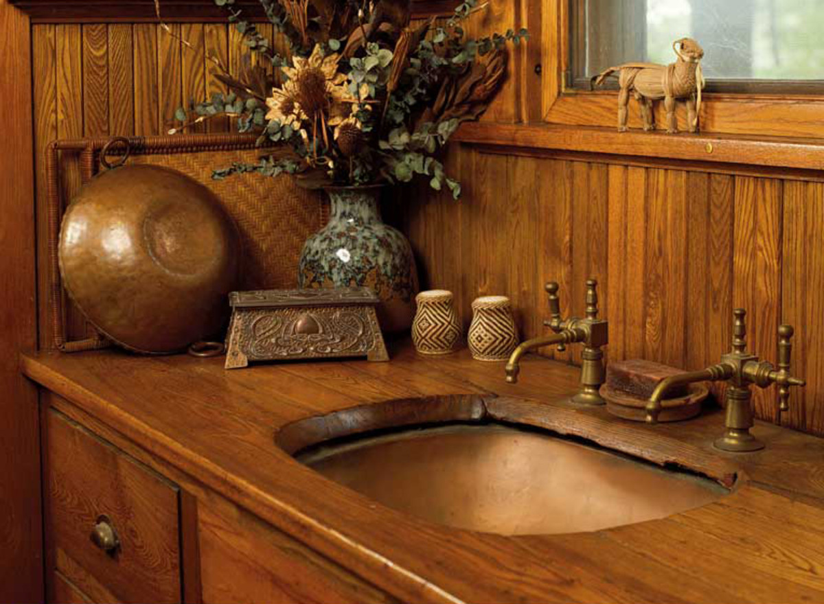 With its separate hot and cold taps and wood counter, an oval undermount copper sink is original to this 1915 pantry. Photo: Dan Mayers