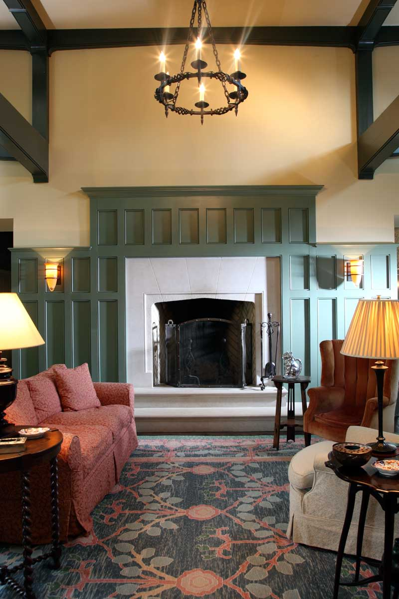 At one end of the beamed great room is a Tudor-style Rumford fireplace with a limestone hearth and surround.