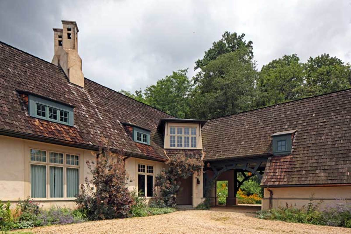 The exterior of the house is inspired by the architecture of C.F.A. Voysey.