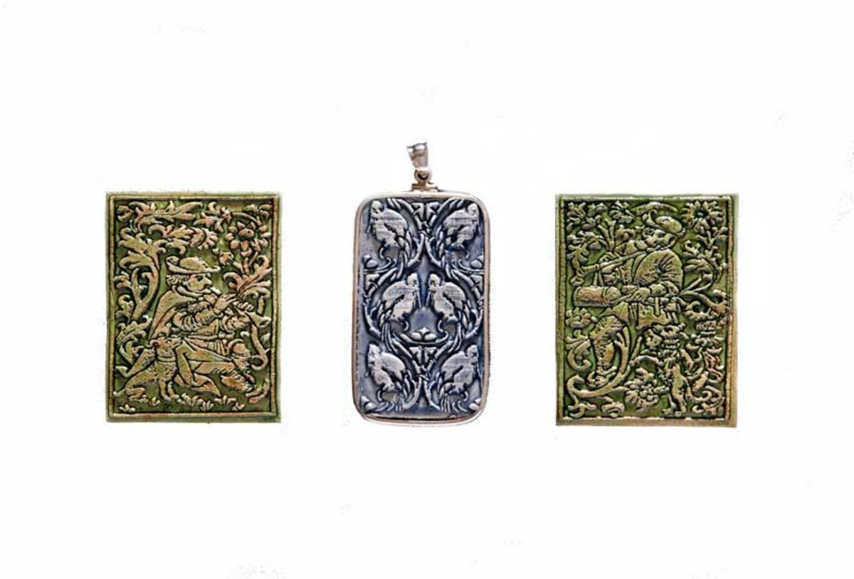 Nancy Froseth's jewelry designs incude two medieval figures on either side of a pendant based on an original pattern by Batchelder.