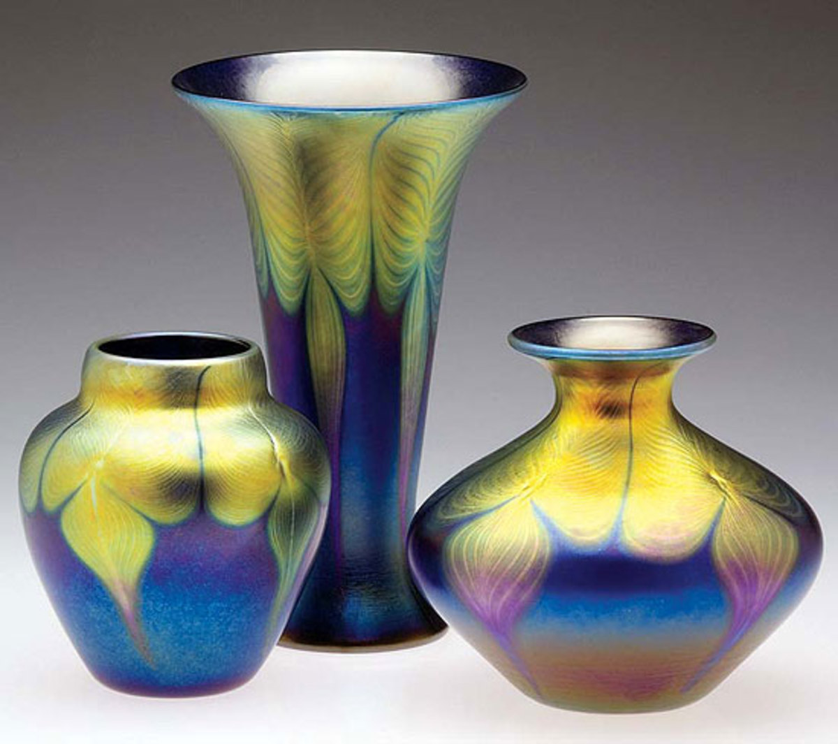 A trio of iridescent art-glass vases from Lundberg Studios.