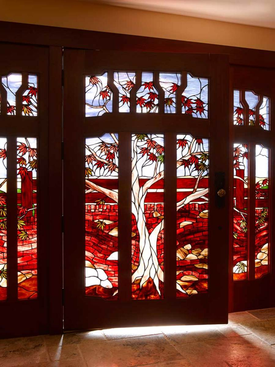 The tripartite front entry combines elements of the garden wall and a Japanese maple on the property in homage to the entry of the Gamble House, designed by Greene & Greene in 1908.