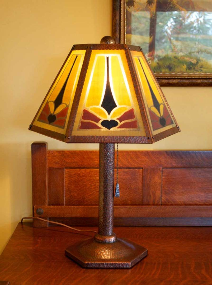 The dragonfly lamp in Stickley Brothers style is topped by a fine-mesh shade hand-painted by Barbara Helberg.