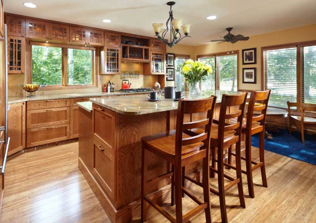 The kitchen offers ample storage and seating. Flooring is bamboo.
