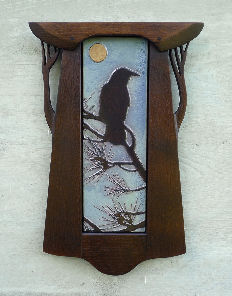 'Crow in Pines' quarter-sawn oak-framed art tile from Mission Guild Studio.