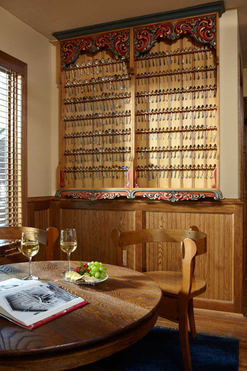 The hand-carved Norwegian cabinet, which holds 200 collectible spoons.