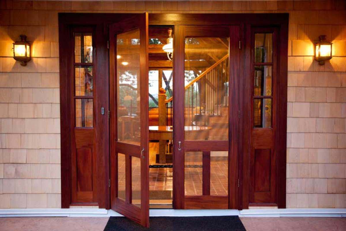 A double screen door with sidelights, in mahogany. The company also builds solid-wood entry sets with sidelights and transoms.