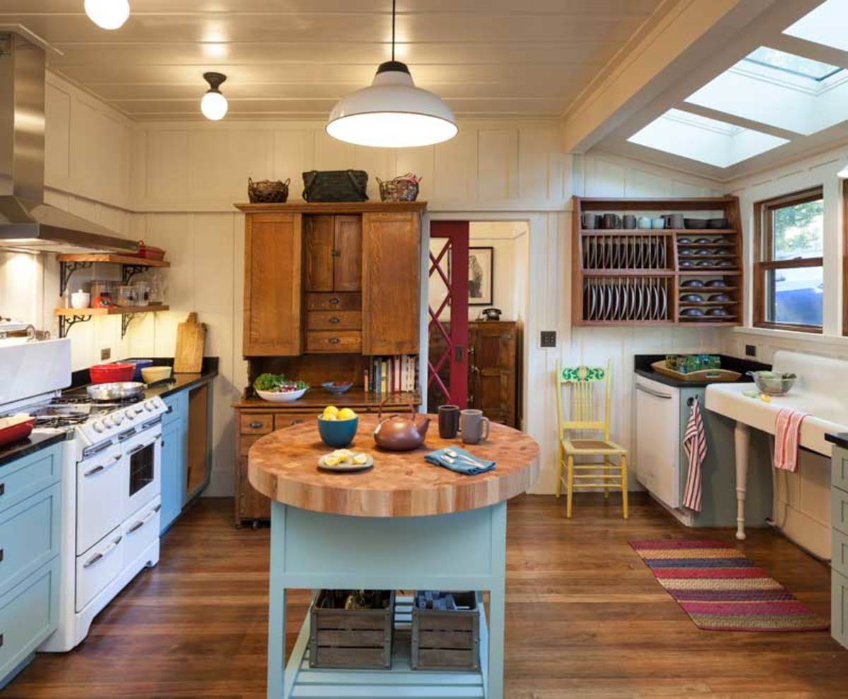 The kitchen was enlarged with a six-foot-wide sink alcove. Vintage touches include the farmhouse sink and a 1952 restored stove.