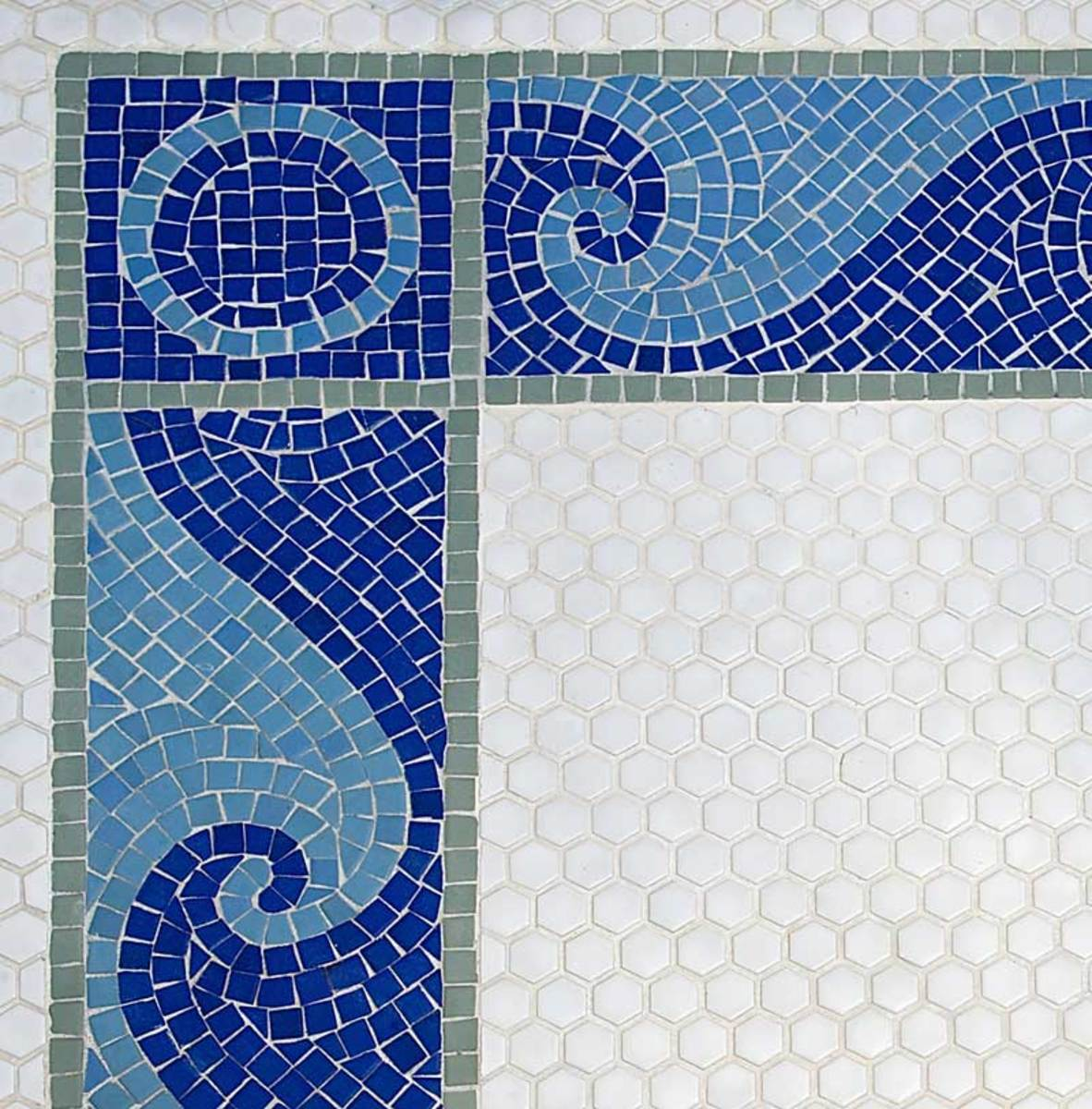 Mosaics create a wave border in the seashell bath.