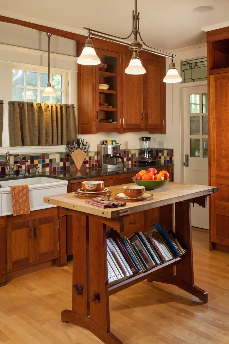 Arts & Crafts-inspired cabinets have wooden pulls.