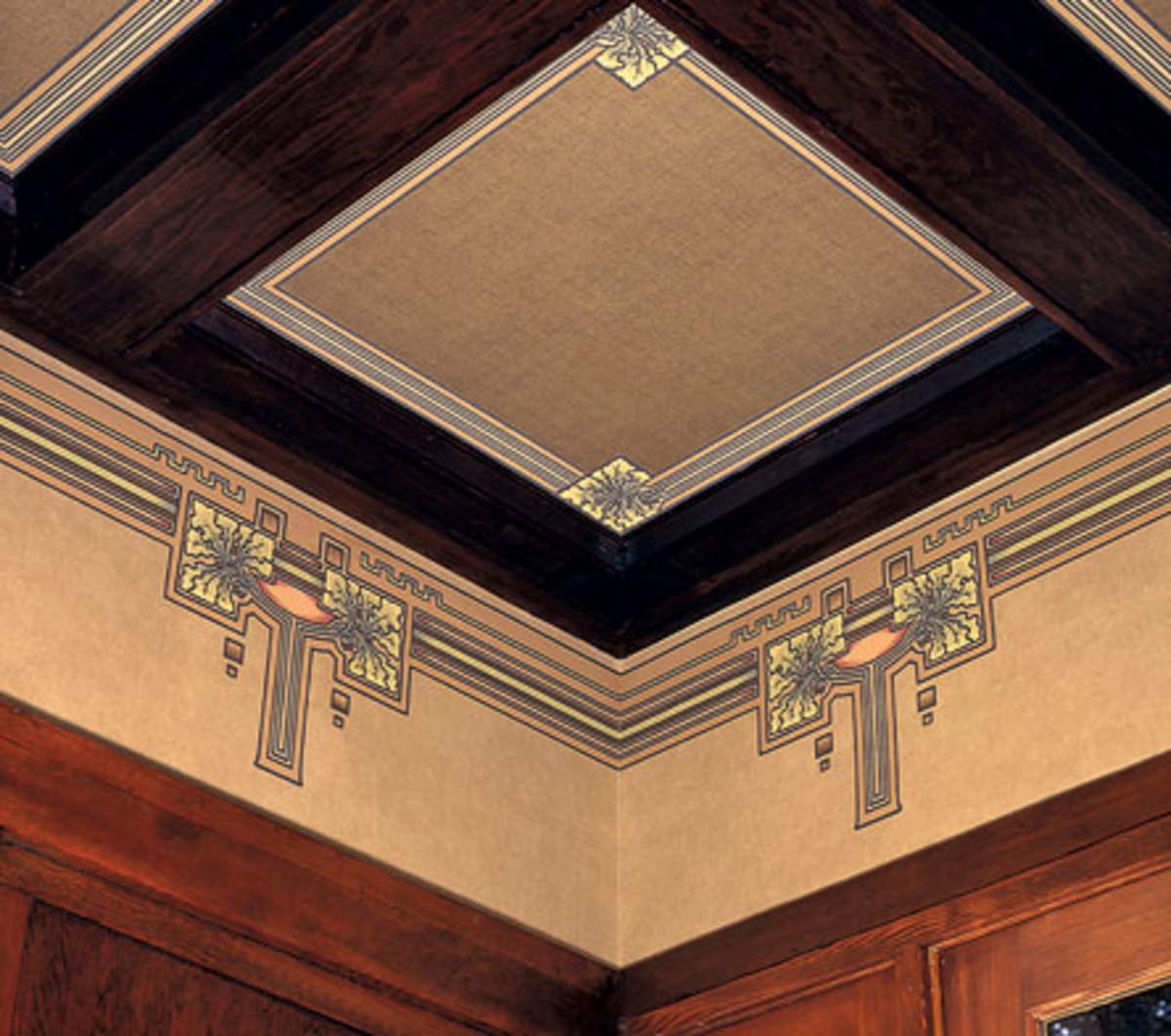 This trompe-l'oeil treatment, all done in paper, mimics the look of decorated panels between beams. Note the burlap-like texture in the enter panel.