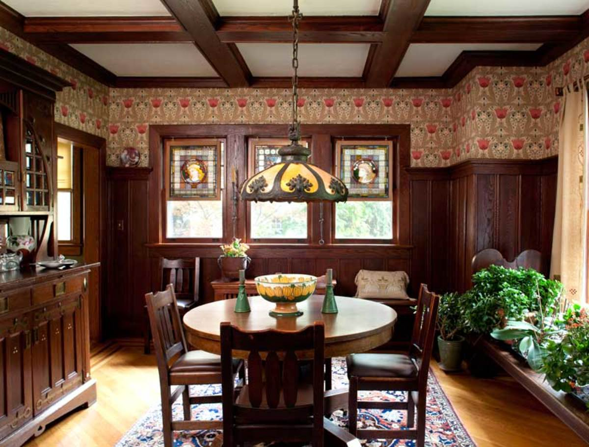 The dining room is papered in 'Tulip Garden,' a reproduction paper.