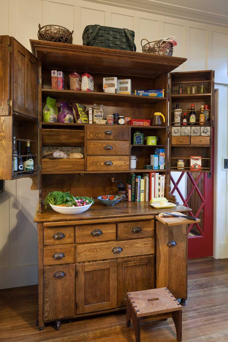An antique oak Hoosier is a charming way to add storage along with period appeal.
