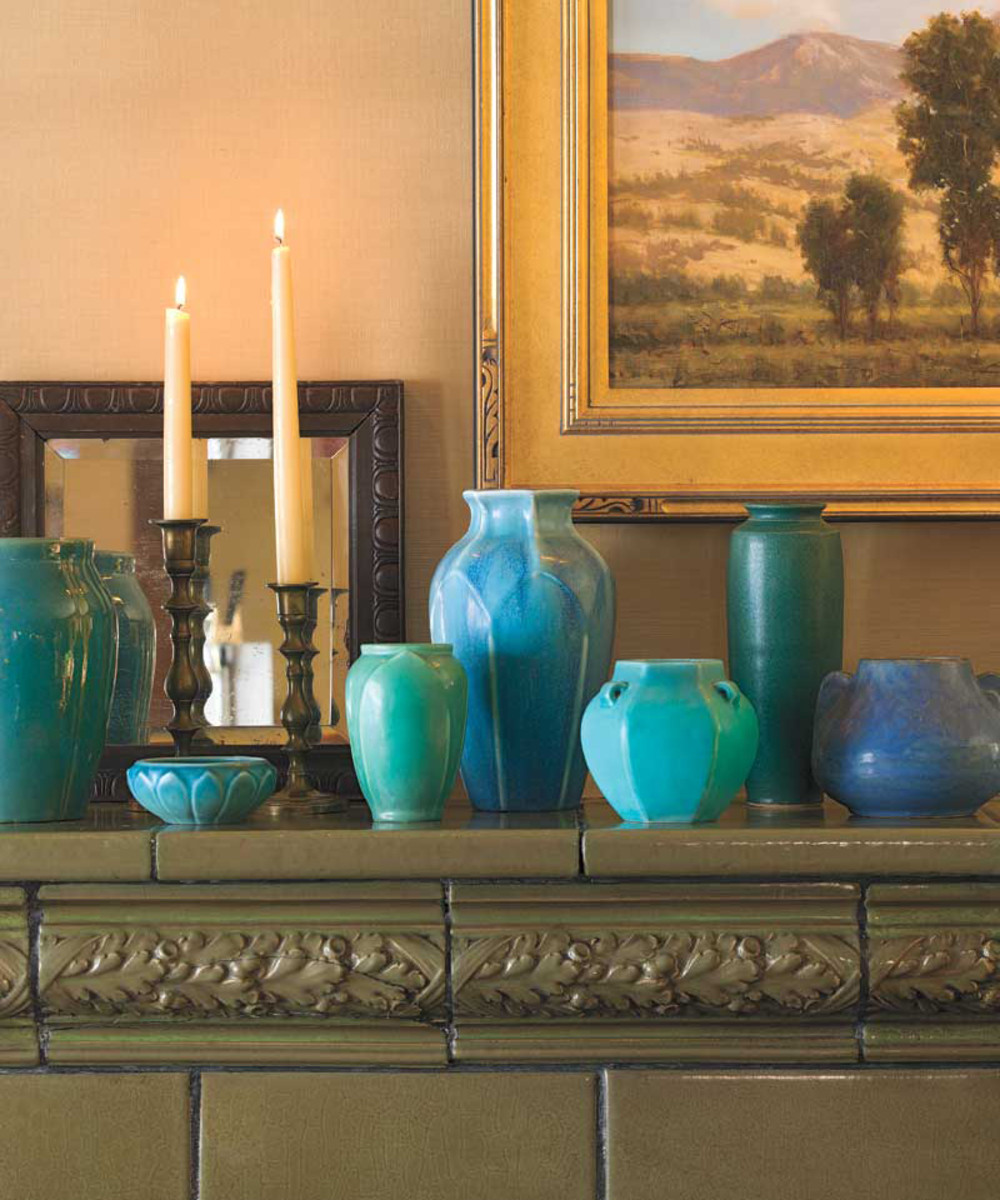 Collected Rosewood and Van Briggle pottery decorate the mantel of a Salt Lake City Tudor.