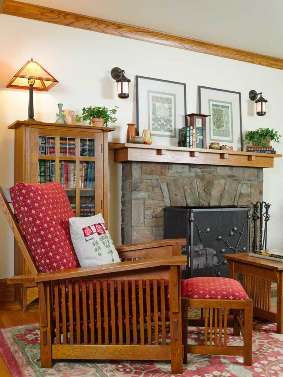The fireplace of local stone is original to the house. A new mantel is better suited to the Arts & Crafts interior of the bungalow.