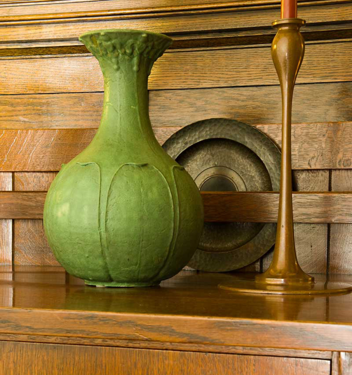 An antique Grueby vase complements the warm tones of oak and copper. Photo: Edward Addeo