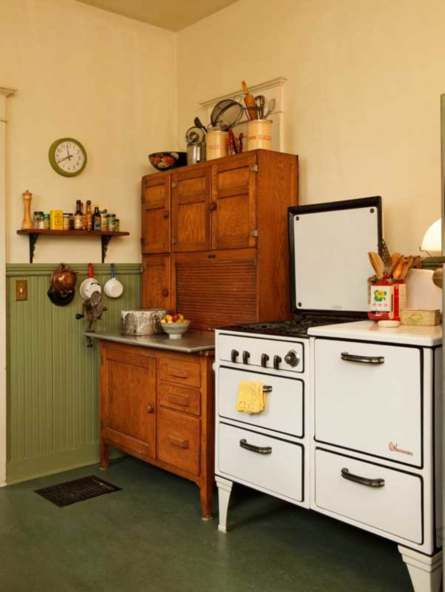 "The heavy, well-built 1930s stove is ""every bit as good"" as the modern stainless range it replaced. The old Hoosier cabinet was $400 at auction."