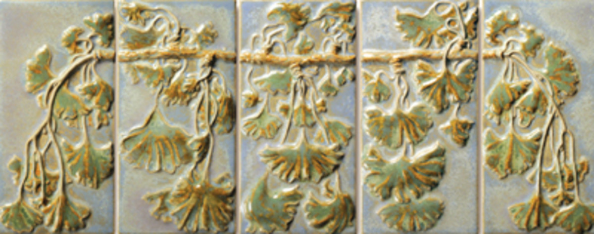 A Terra Firma Art Tile panel embellished in glazes of rich Craftsman colors and complex patinas.