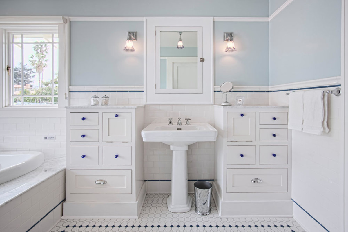 White master bath with accents of cobalt blue