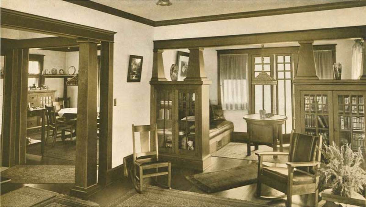 Adjoining rooms in a house pictured in The Home Beautiful, published in 1915, are fitted with bookcases.
