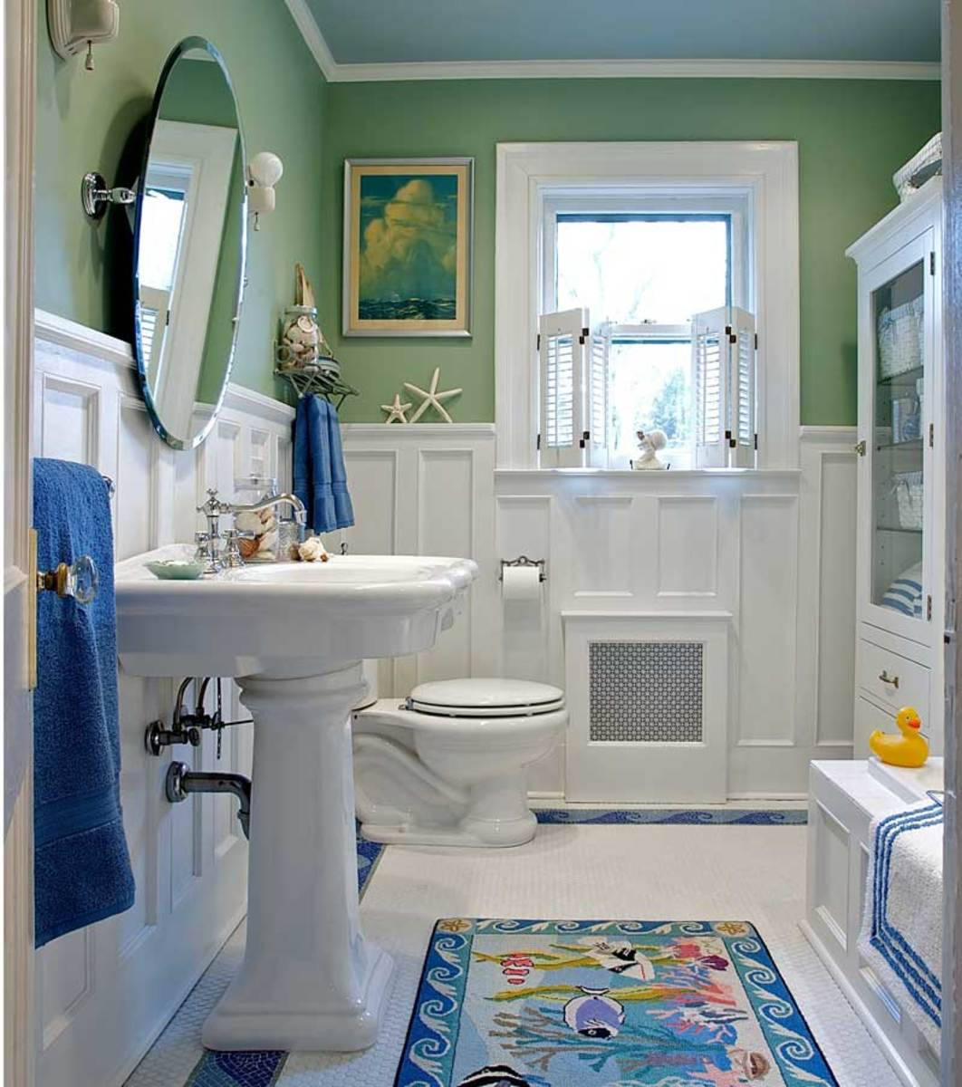 """sanitary"" white bathroom designed by Carisa Mahnken"
