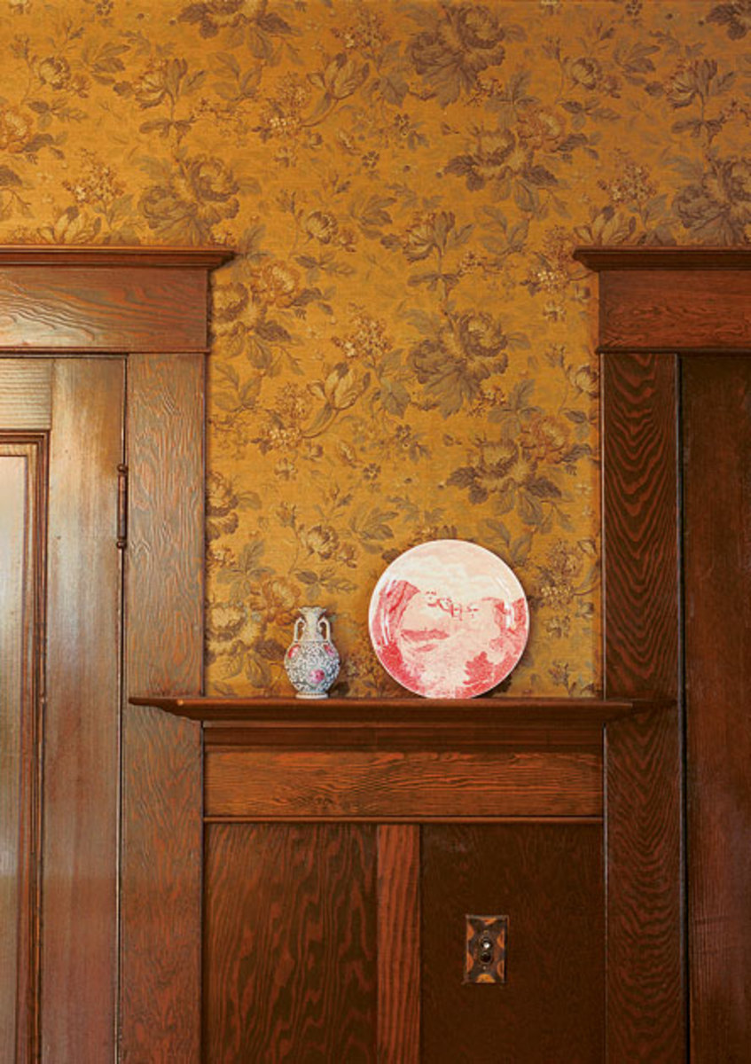 An old tapestry paper complements a wainscot in an Arts & Crafts interior.