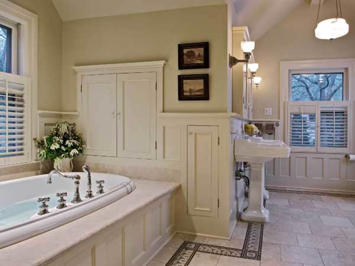 Capturing wasted space under the eaves meant room for storage separate from vanity cabinets, allowing the use of pedestal sinks.