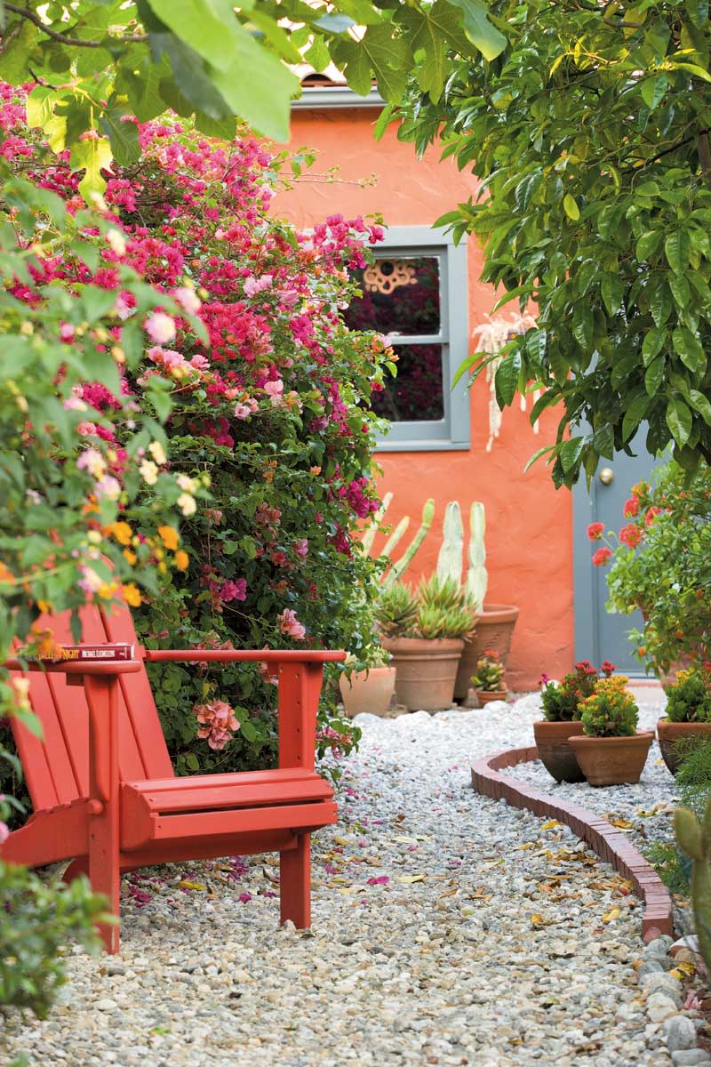 Beyond the patio, the view toward the stuccoed garage takes in bougainvillea. Photos by William Wright