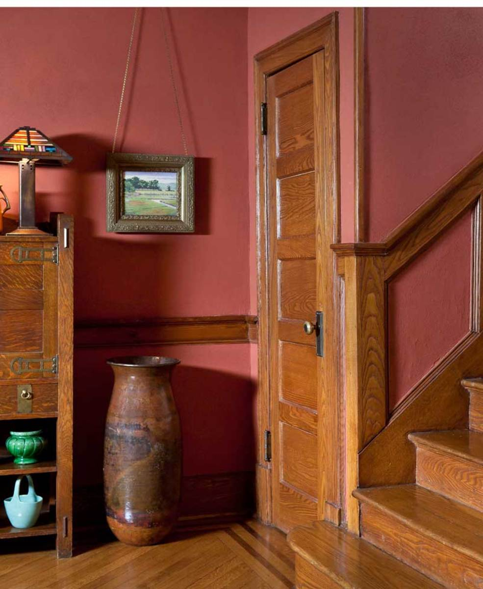 Sand paint was used in the entry hall of this 1917 house; the color is 'Roycroft Adobe' from Sherwin-Williams' Historic Collection. Photo: Gross & Daley