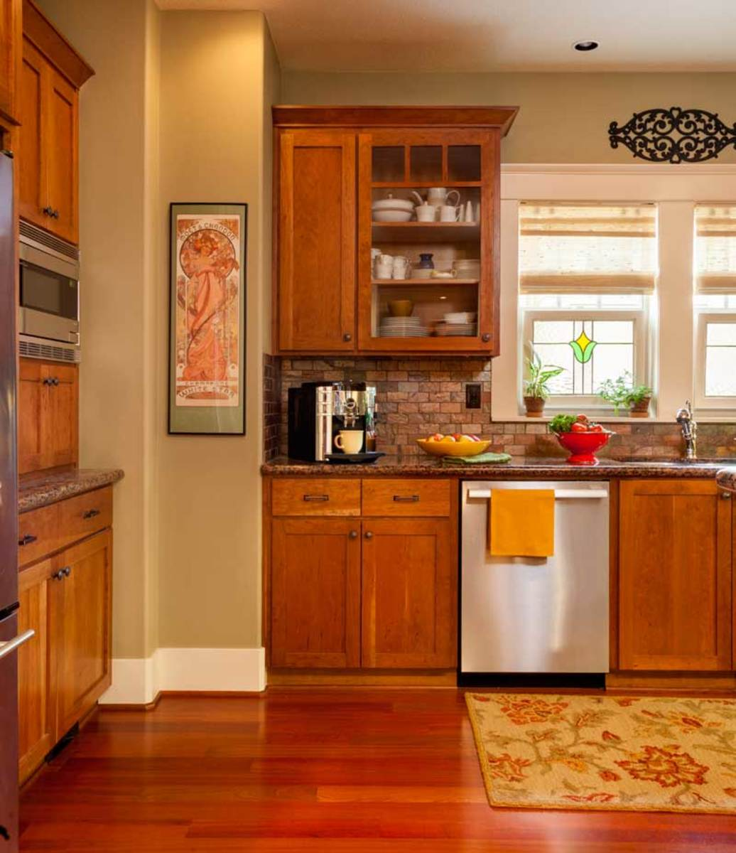 Strong, natural materials define the kitchen: cherry cabinets, granite countertops, travertine tile, and stainless steel.