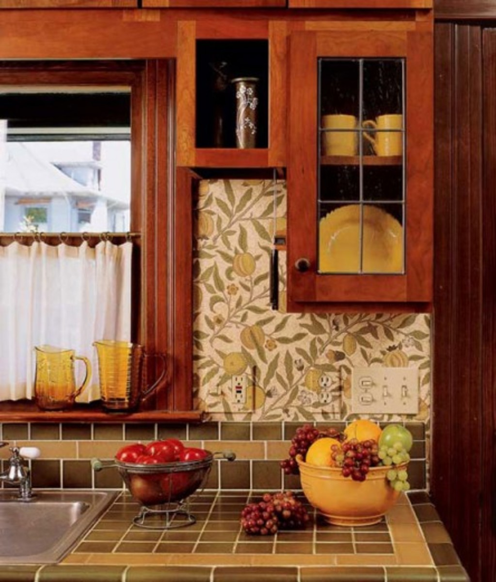Very simple cabinets look pleasingly old-fashioned accompanied by earthy tile countertops and William Morris-designed 'Fruit' wallpaper, all done in the same palette. Photo by William Wright.