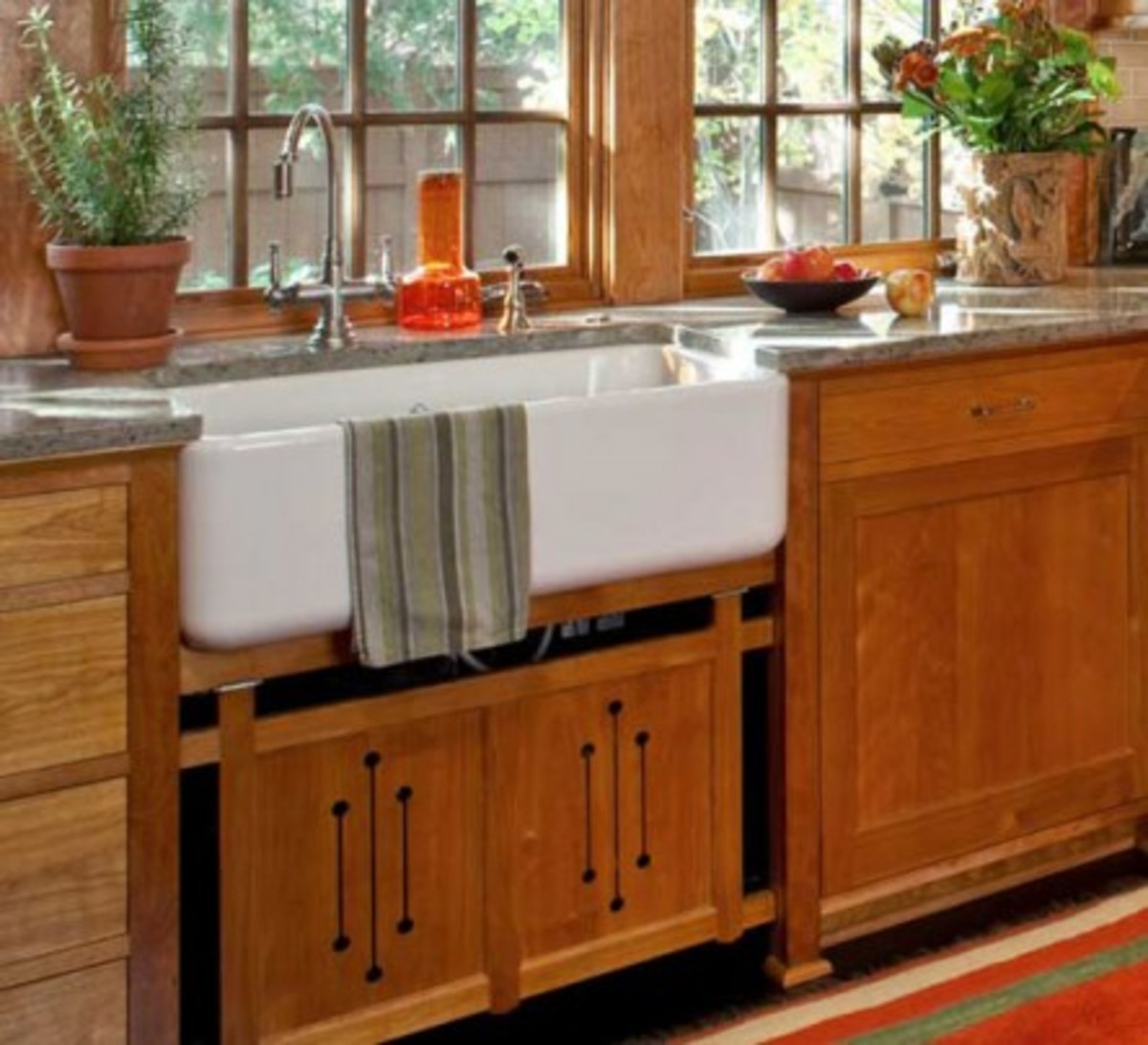 Cutout designs and crossed corners are Prairie-influenced elements in a kitchen with red birch cabinets, in an addition by David Heide to his own 1922 Prairie Style house. Photo by William Wright.