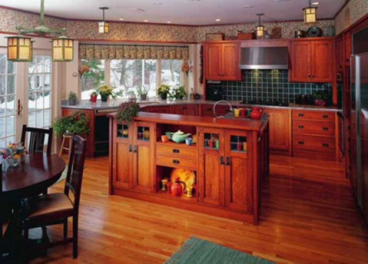 A spectacular Revival kitchen by The Kennebec Company features oak cabinets with Craftsman furniture pulls, in context with dining room-quality lighting and finishes.
